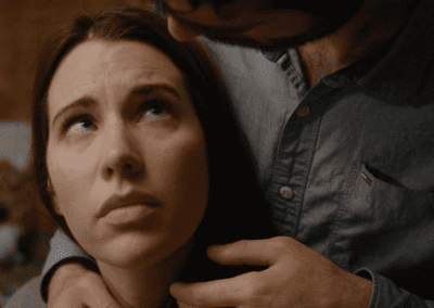 Woman looking up to a man who is caressing her neck