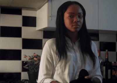 Woman standing in a dark kitchen